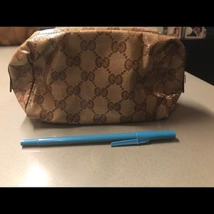 Gucci monogram cosmetic pouch
